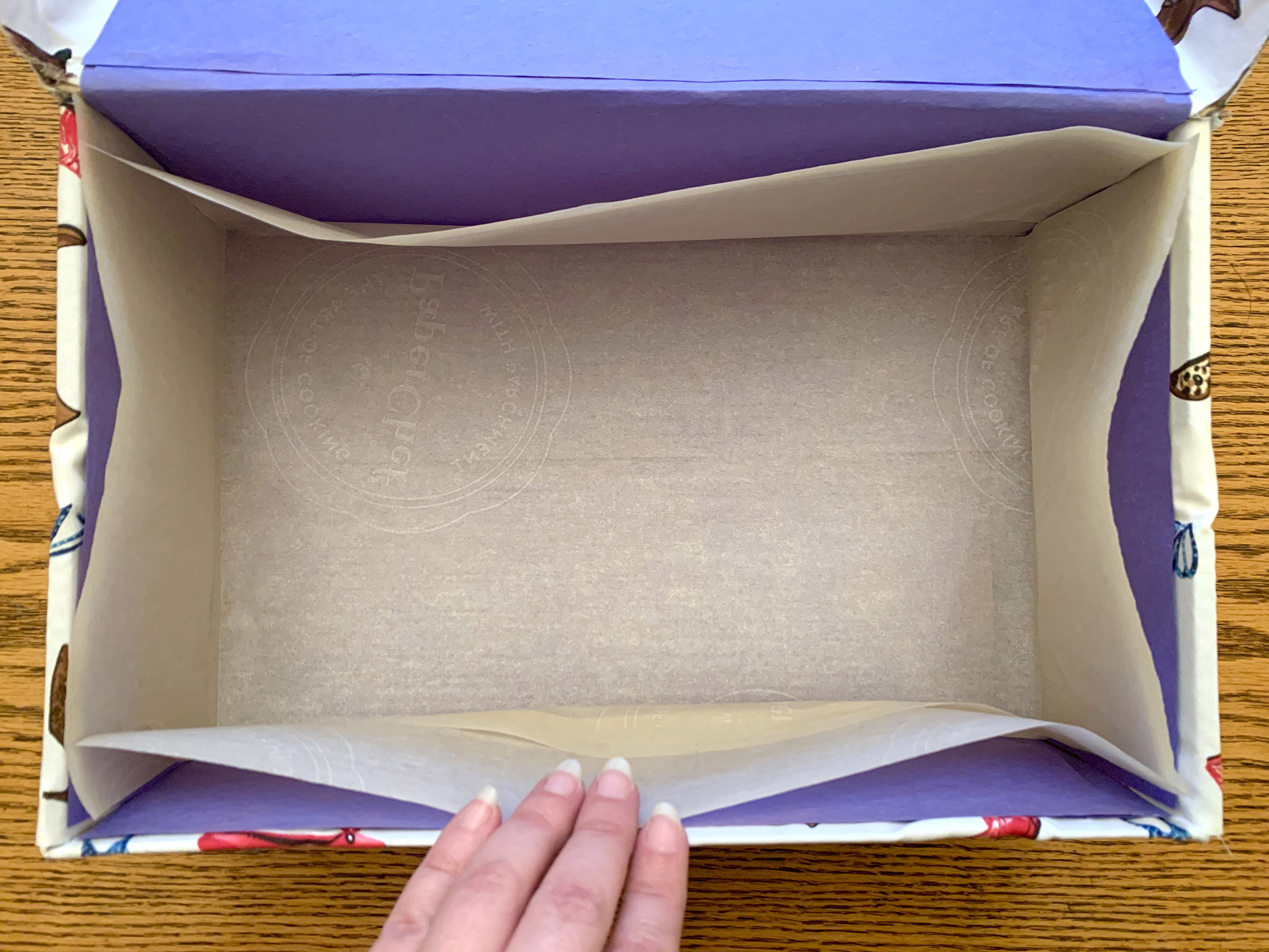 photo of the open box with parchment paper inside