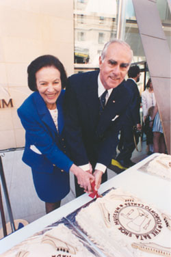 image of Mrs. bata cutting a cake at the opening ceremony.
